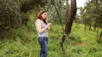 beautiful girl talking on the phone in countryside