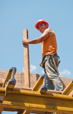 Smiling construction worker with formwork beam poster