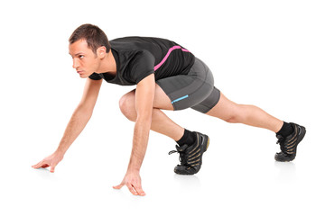 Male athlete ready to run