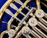 Close up of the valves and keys of a concert french horn
