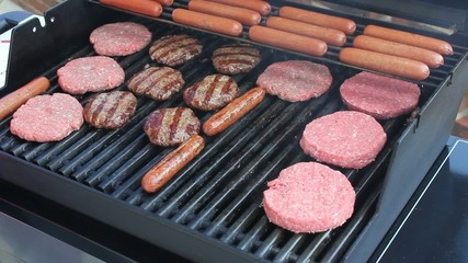 Grilling Out Burgers And Hotdogs