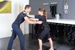 EMS Training - Trainer mit Praktikantin im Studio