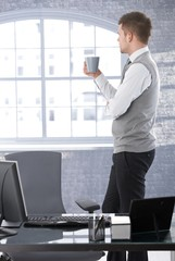 Businessman thinking drinking tea