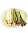 white and green asparagus on green plate