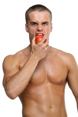 Muscle sexy wet naked young man eating the red apple