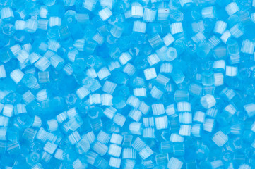 background of blue decorative plastic craft beads