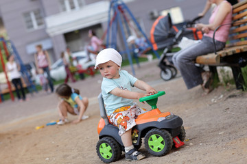 Child drives toy ATV
