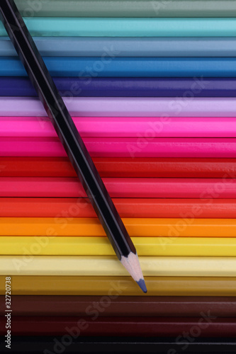Black pencil on top of colored ones
