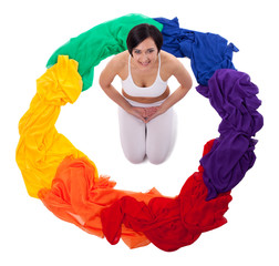 Yong woman doing yoga exercise in rainbow color