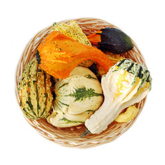 Osier basket with various colorful squashes and pumpkins