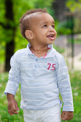 Portrait of a black baby boy playing  at the park