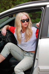 Young woman waiting impatiently in car