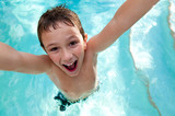 Joyful kid in a swimming pool.
