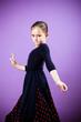 Niña vestida de flamenca