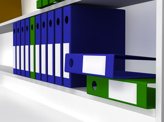 Green and blue folders laying on shelf