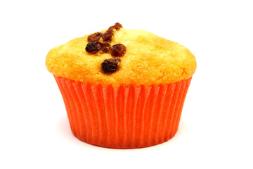 Tasty yellow muffin with many brown raisins