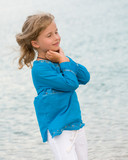 Happy childhood - dreaming  girl on the beach poster