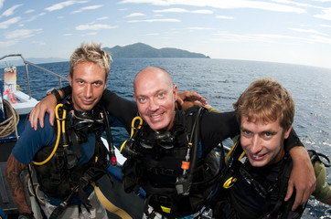 scuba divers on surface before a dive