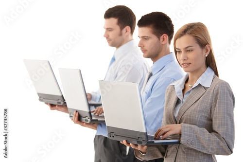 Young businesspeople with individual laptops