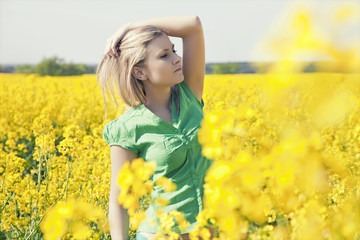 Young woman relaxing on a green meadow