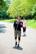 beautiful asian women jogging in the park