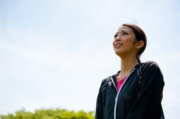 beautiful asian woman exercising in the park