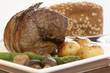 Roast beef with potatoes, asparagus and mushrooms.