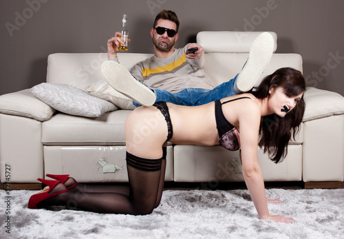 Total domination.A man using his girlfriend as a coffee table