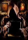 Monk in church