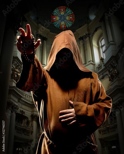 Preaching monk in church