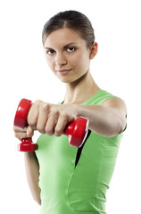 The girl in sports form with red dumbbells in hands