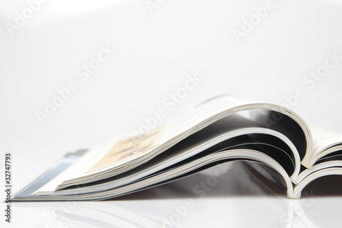 Leinwandbild Motiv Offene Zeitschriften