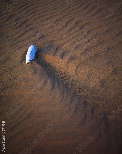 Garbage On A Sandy Beach