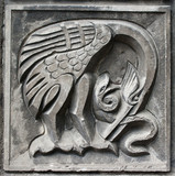 old bas-relief of fairytale heron and snake poster