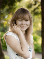 Portrait of young smiling girl in the park