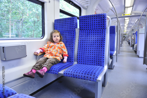 Little Girl Riding a Train 2