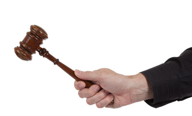 Hand holding a Brown gavel on a white background