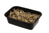 Dried and salted sunflower seeds in plastic bowl