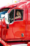 Pretty blonde woman driving a big truck
