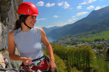 Woman rock climber with helmet, outdoor portrait