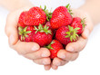 Handful of strawberries close-up