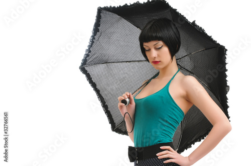sad young girl with umbrella