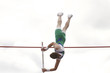 Male athlete competing in the pole vault