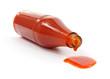 Hot sauce spilling from bottle - 32773525
