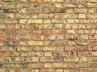 Yellow brickwork as a grunge wallpaper.