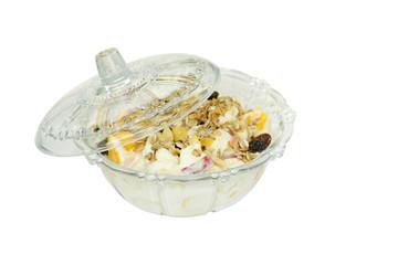 Delicious fresh fruits with yogurt and muesli at shallow DOF