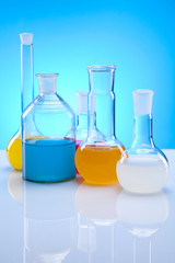 Laboratory flasks with fluids of different colors