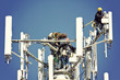 Crew installing antennas