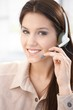 Attractive customer servicer smiling