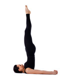 Yong woman doing yoga - sarvangasana isolated